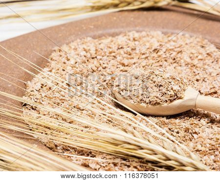 Closeup Of Wooden Spoon Filled With Wheat Bran