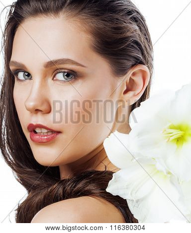 young pretty woman with  Amarilis flower close up isolated on white