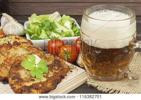 Potato pancakes and beer glasses.