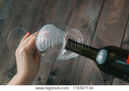 Female Take Wine Glass On Dark Toned Table