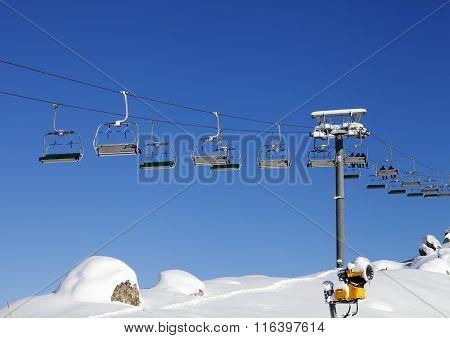Chair-lift At Ski Resort At Sun Day After Snowfall