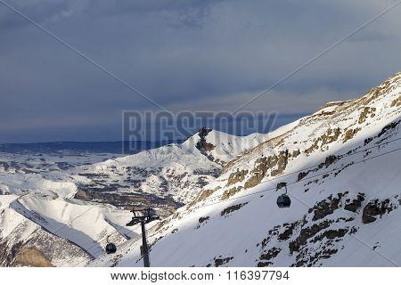 Gondola Lift On Ski Resort At Sun Evening