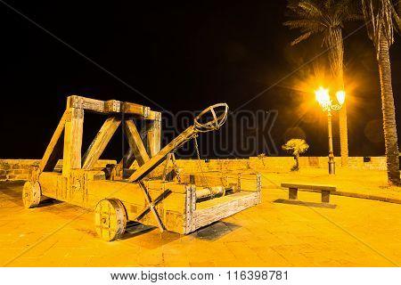 Antique Catapult In Alghero At Night