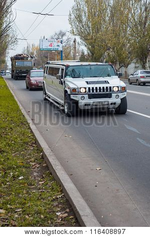 White Hummer H2 Limousine At The City Street
