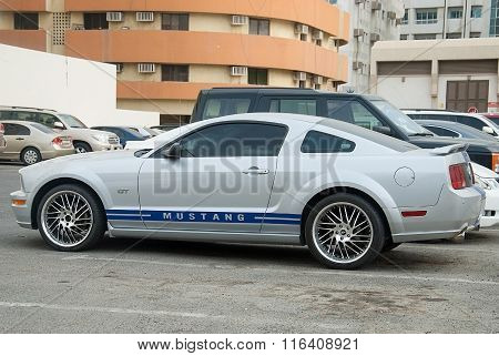 Silver Ford Mustang Stands On The City Parking