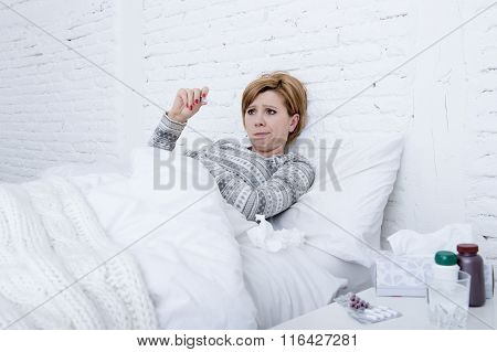 Sick Woman In Bed Checking Temperature With Thermometer Feverish Weak Suffering Cold Winter Flu Viru
