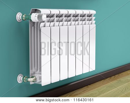 White contemporary heating radiator with thermostat poster