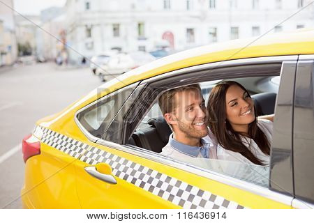 Young couple in a yellow taxi