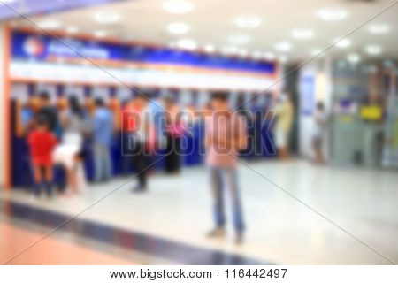 Blurry De-focused Background People Withdraw Money Automatic Teller Machine.