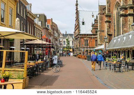 People Walking Near The Grote Kerk (sint-bavokerk) In The  Historic Center Of Haarlem, The Netherlan