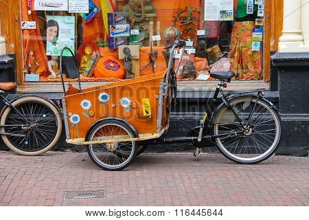 Bright Tricycle With A Big Luggage Basket On Kruisstraat Street In Haarlem, The Netherlands