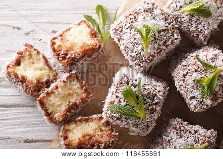 Freshly Baked Cakes Lamington Close-up On The Table. Horizontal Top View