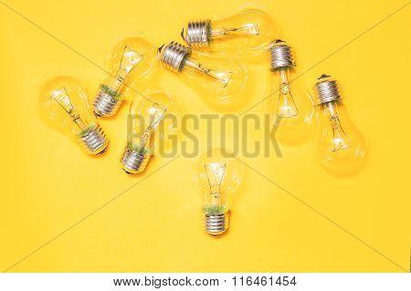 Light bulb on yellow background
