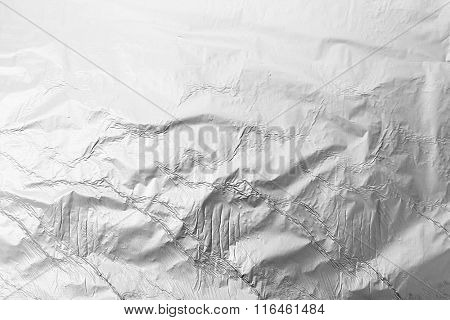 Silver crumpled foil background