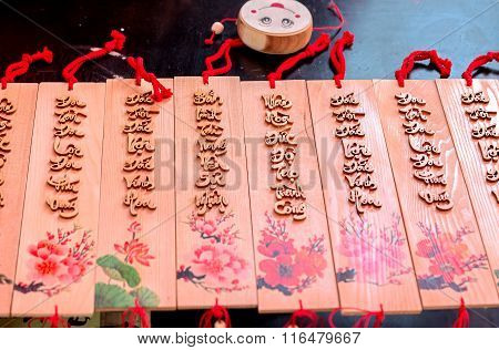 Painting New Year couplets written on wood