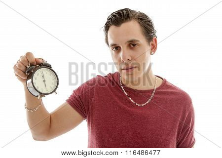 Young Man Is Holding Alarm Clock