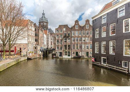 Amsterdam Canals and Saint Nicholas church Netherlands