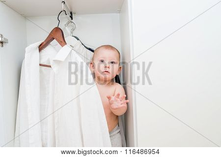 Little Child Trying On Clothes