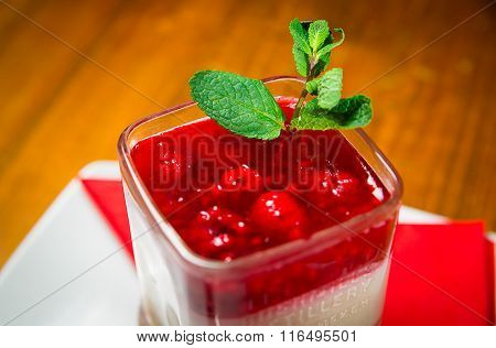Cheesecake served in a glass, ready for consummation. Dessert.