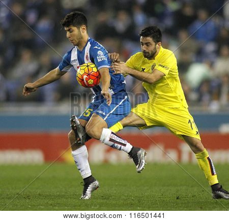 BARCELONA - JAN, 23: Marco Asensio(L) of RCD Espanyol fights with Jaume Costa(R) of Villareal CF during a Spanish League match at the Estadi Cornella on January 23, 2016 in Barcelona, Spain