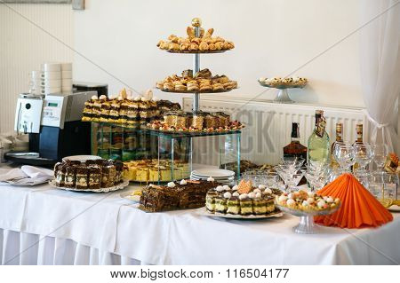 Stylish Luxury Tables With Sweets For The Celebration For A Wedding Of Happy Couple, Cathering In Th