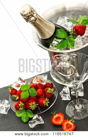 Champagne and two glasses over white background. Festive arrangement with sparkling wine and fresh strawberries. Selective focus poster