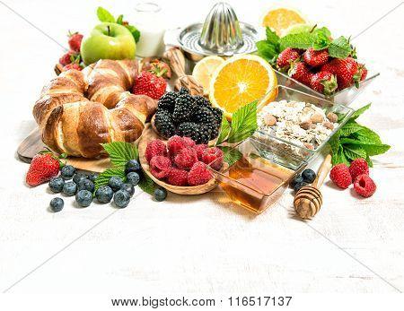 Breakfast With Croissants, Muesli, Fresh Berries, Fruits. Healthy Food