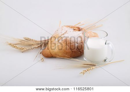 Milk In A Transparent Mug And A Rich Roll