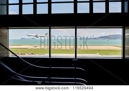 HONG KONG - JUNE 04, 2015: Cathay Pacific aircraft landing at Hong Kong airport. Cathay Pacific is the flag carrier of Hong Kong