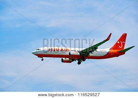 HONG KONG - JUNE 04, 2015: Jeju Air aircraft landing at Hong Kong airport. Jeju Air is a low cost airline based in Jeju City, Jeju-do, South Korea