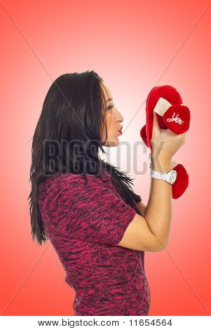 Profile Of Woman Kissing Heart Toy