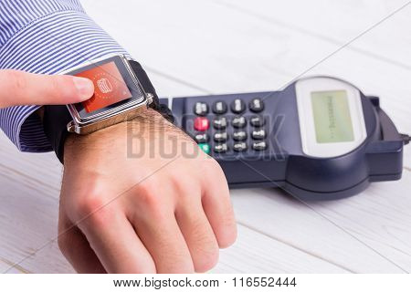 Web against man using smart watch to express pay