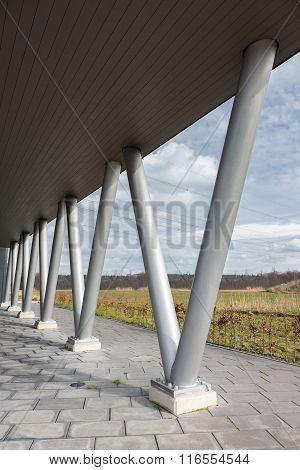 V- Shaped Metal Pillars Under Roof Of Building