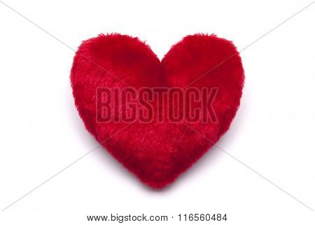 Plush red heart on white background