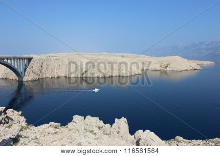 Mediterranian seaside view with rocky mountains and bridge
