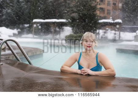healthy mature woman at pool in snow