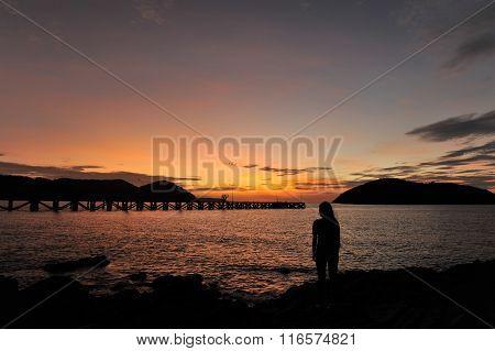 woman on beach in twilight