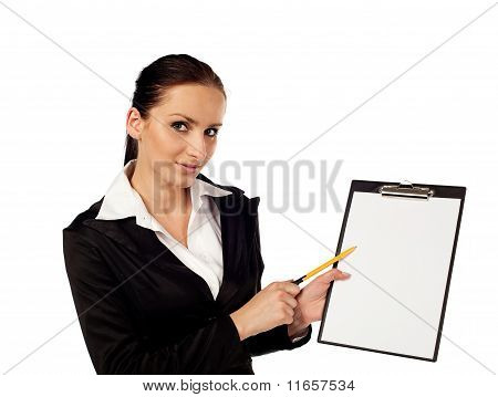 Businesswoman Pointing On Clipboard