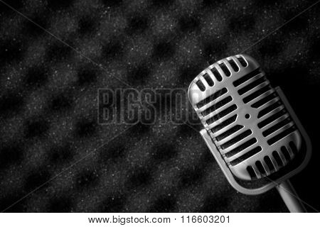 vintage microphone on acoustic foam poster
