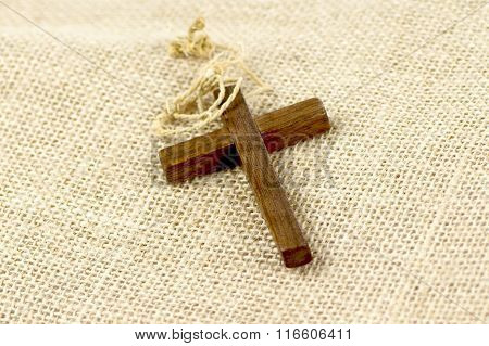 Wooden cross  on sackcloth