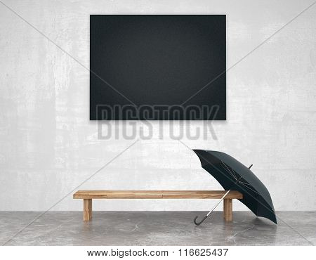 Blank Black Picture Above Wooden Bench With Black Umbrella In Empty Loft Room With Concrete Floor, M