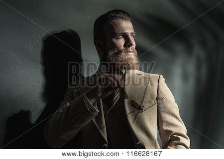 Stern Thoughtful Bearded Man In Stylish Clothes