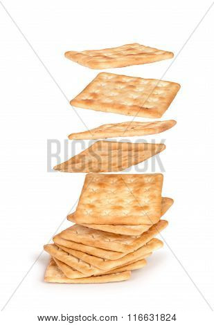 The Crackers Fall On The Stack Of Square Crackers Isolated On White Background