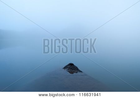 Stone in mountain lake, minimalism