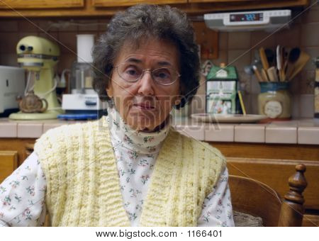 Kindly Grandmother In Kitchen