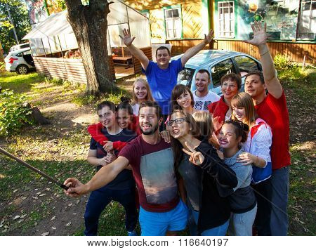 Group Of Happy People Taking Selfie Outdoors