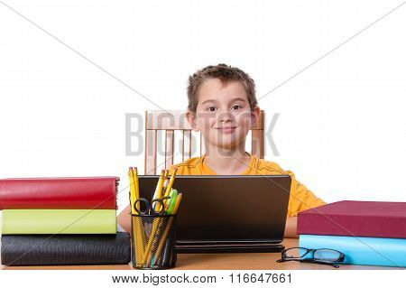 Smiling Boy With Laptop And Large Books