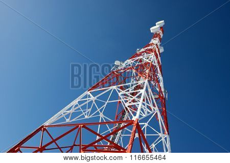 Telecommunications tower with clear blue sky. poster