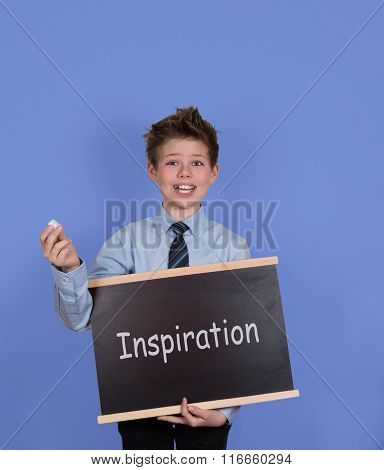 Inspiration concept, getting inspired be creative, create and invent. Boy with Blackboard Slate on B