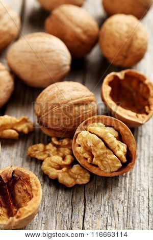 Walnuts On A Grey Wooden Table